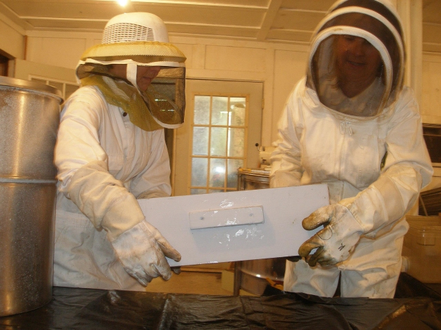 It takes two of us to move the heavy supers into the honey house.